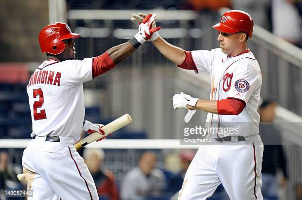 Adam LaRoche of the Washington Nationals celebrates with Roger Bernadina after scoring the game winning run in the eighth inning against the Houston...