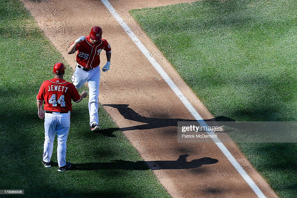 <a gi-track='captionPersonalityLinkClicked' href=/galleries/search?phrase=Adam+LaRoche&family=editorial&specificpeople=216533 ng-click='$event.stopPropagation()'>Adam LaRoche</a> #25 of the Washington Nationals celebrates with Trent Jewett #44 after hitting a solo home run in the fourth inning of a game against the San Diego Padres at Nationals Park on July 6, 2013 in Washington, DC.