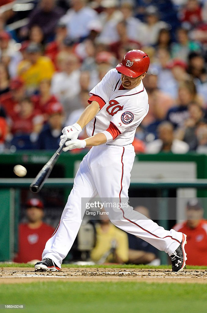 <a gi-track='captionPersonalityLinkClicked' href=/galleries/search?phrase=Adam+LaRoche&family=editorial&specificpeople=216533 ng-click='$event.stopPropagation()'>Adam LaRoche</a> #25 of the Washington Nationals drives in a run with a single in the first inning against the Chicago White Sox at Nationals Park on April 11, 2013 in Washington, DC.