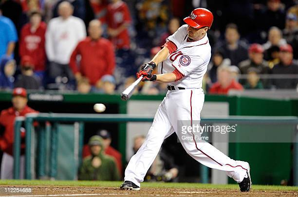 Adam LaRoche of the Washington Nationals drives in the winning run in the tenth inning against the Milwaukee Brewers at Nationals Park on April 15...