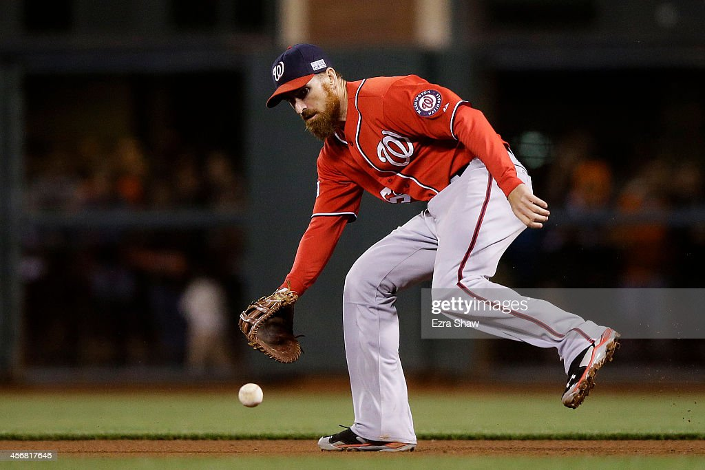 <a gi-track='captionPersonalityLinkClicked' href=/galleries/search?phrase=Adam+LaRoche&family=editorial&specificpeople=216533 ng-click='$event.stopPropagation()'>Adam LaRoche</a> #25 of the Washington Nationals fields a ball hit by Brandon Crawford #35 of the San Francisco Giants for an out in the fourth inning during Game Four of the National League Division Series at AT&T Park on October 7, 2014 in San Francisco, California.