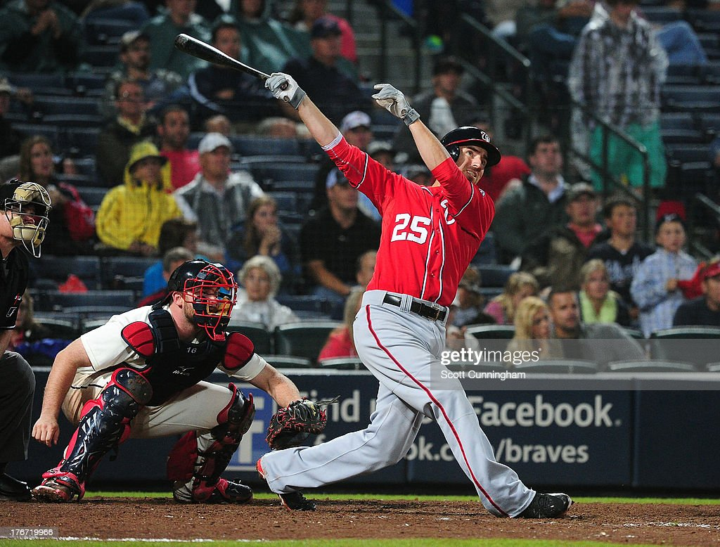 <a gi-track='captionPersonalityLinkClicked' href=/galleries/search?phrase=Adam+LaRoche&family=editorial&specificpeople=216533 ng-click='$event.stopPropagation()'>Adam LaRoche</a> #25 of the Washington Nationals hits a 15th inning home run against the Atlanta Braves at Turner Field on August 17, 2013 in Atlanta, Georgia.