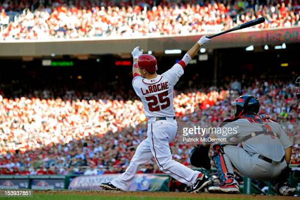 Adam LaRoche of the Washington Nationals hits a solo home run in the bottom of the second inning against the St Louis Cardinals during Game Four of...