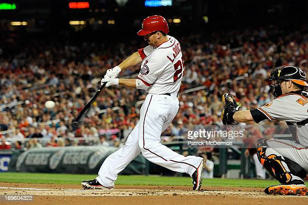 Adam LaRoche of the Washington Nationals hits a three run home run in the first inning during an interleague game against the Baltimore Orioles at...