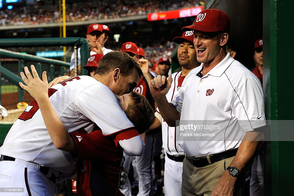 <a gi-track='captionPersonalityLinkClicked' href=/galleries/search?phrase=Adam+LaRoche&family=editorial&specificpeople=216533 ng-click='$event.stopPropagation()'>Adam LaRoche</a> #25 of the Washington Nationals hugs his son after hitting a solo home run in the fifth inning of a game against the Pittsburgh Pirates at Nationals Park on July 22, 2013 in Washington, DC.