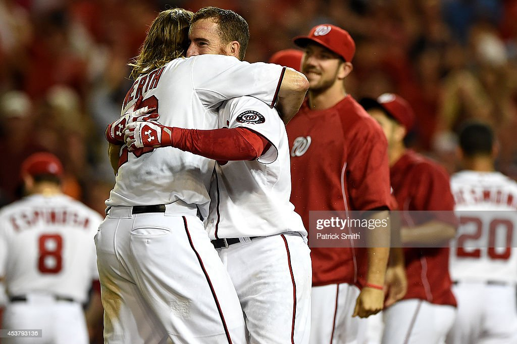 <a gi-track='captionPersonalityLinkClicked' href=/galleries/search?phrase=Adam+LaRoche&family=editorial&specificpeople=216533 ng-click='$event.stopPropagation()'>Adam LaRoche</a> #25 of the Washington Nationals hugs teammate <a gi-track='captionPersonalityLinkClicked' href=/galleries/search?phrase=Jayson+Werth&family=editorial&specificpeople=206490 ng-click='$event.stopPropagation()'>Jayson Werth</a> #28 after hitting a walk-off solo home run against the Arizona Diamondbacks in the eleventh inning at Nationals Park on August 18, 2014 in Washington, DC. The Washington Nationals won, 5-4, in the eleventh inning.