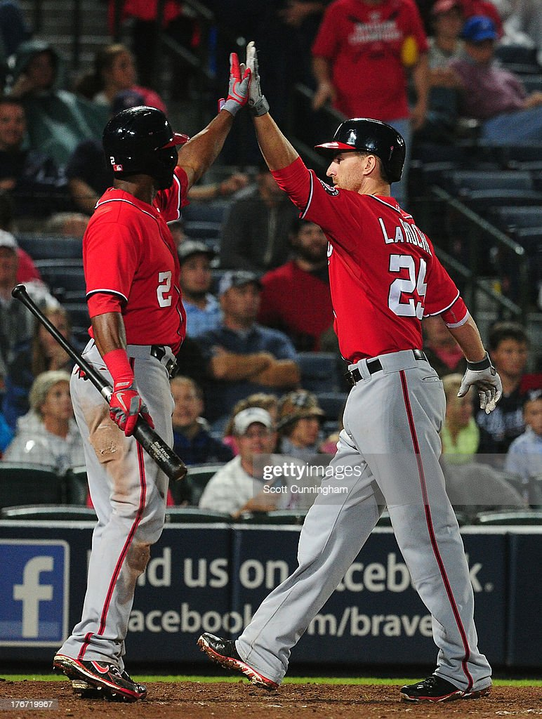 <a gi-track='captionPersonalityLinkClicked' href=/galleries/search?phrase=Adam+LaRoche&family=editorial&specificpeople=216533 ng-click='$event.stopPropagation()'>Adam LaRoche</a> #25 of the Washington Nationals is congratulated by <a gi-track='captionPersonalityLinkClicked' href=/galleries/search?phrase=Denard+Span&family=editorial&specificpeople=835844 ng-click='$event.stopPropagation()'>Denard Span</a> #2 after hitting a 15th inning home run against the Atlanta Braves at Turner Field on August 17, 2013 in Atlanta, Georgia.