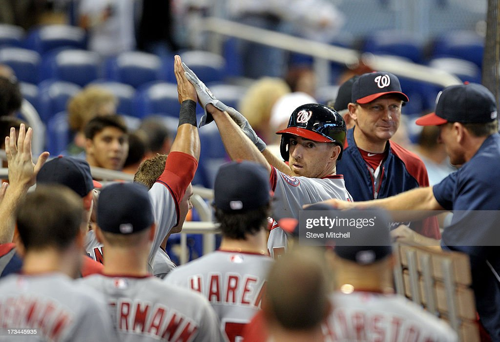 Adam LaRoche #25 of the Washington Nationals is greeted by teammates after scoring a run during the second inning against the Miami Marlins at Marlins Park on July 14, 2013 in Miami, Florida.