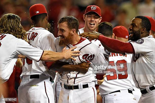 Adam LaRoche of the Washington Nationals is mobbed by teammates after hitting a walkoff solo home run against the Arizona Diamondbacks in the...