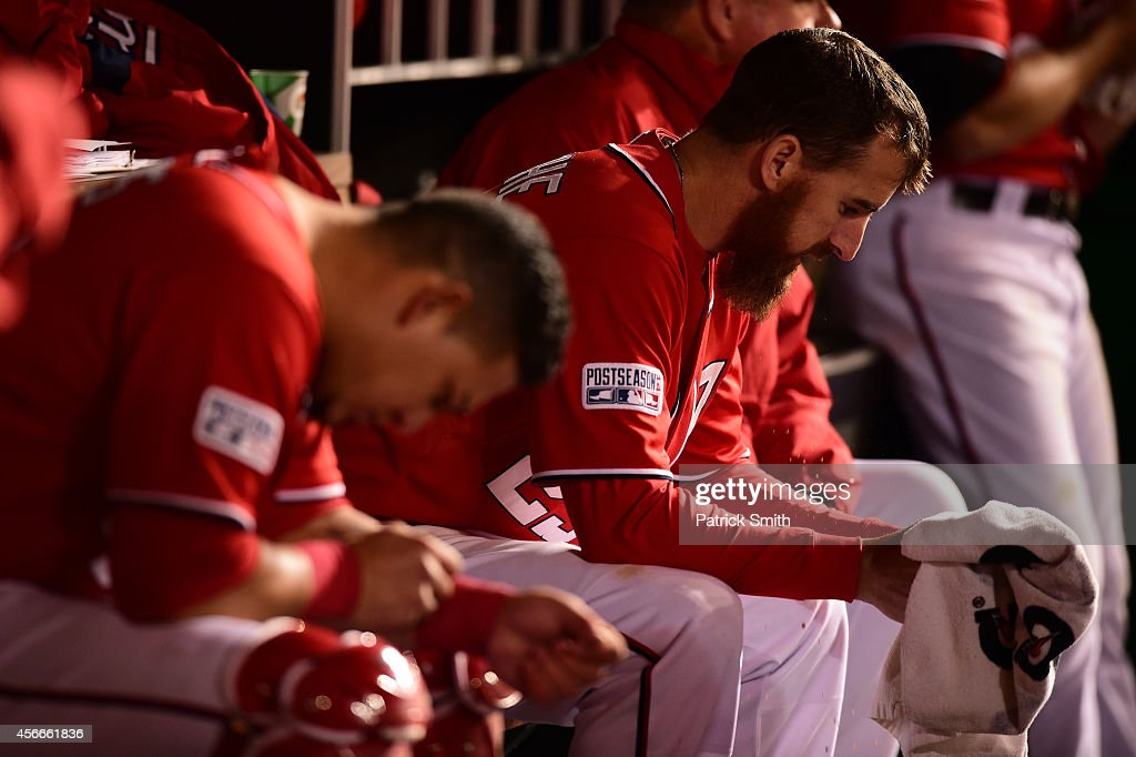 <a gi-track='captionPersonalityLinkClicked' href=/galleries/search?phrase=Adam+LaRoche&family=editorial&specificpeople=216533 ng-click='$event.stopPropagation()'>Adam LaRoche</a> #25 of the Washington Nationals looks on in the dugout in the eighteenth inning against the San Francisco Giants during Game Two of the National League Division Series at Nationals Park on October 4, 2014 in Washington, DC.