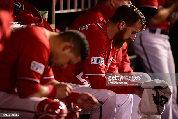 Adam LaRoche of the Washington Nationals looks on in the dugout in the eighteenth inning against the San Francisco Giants during Game Two of the...