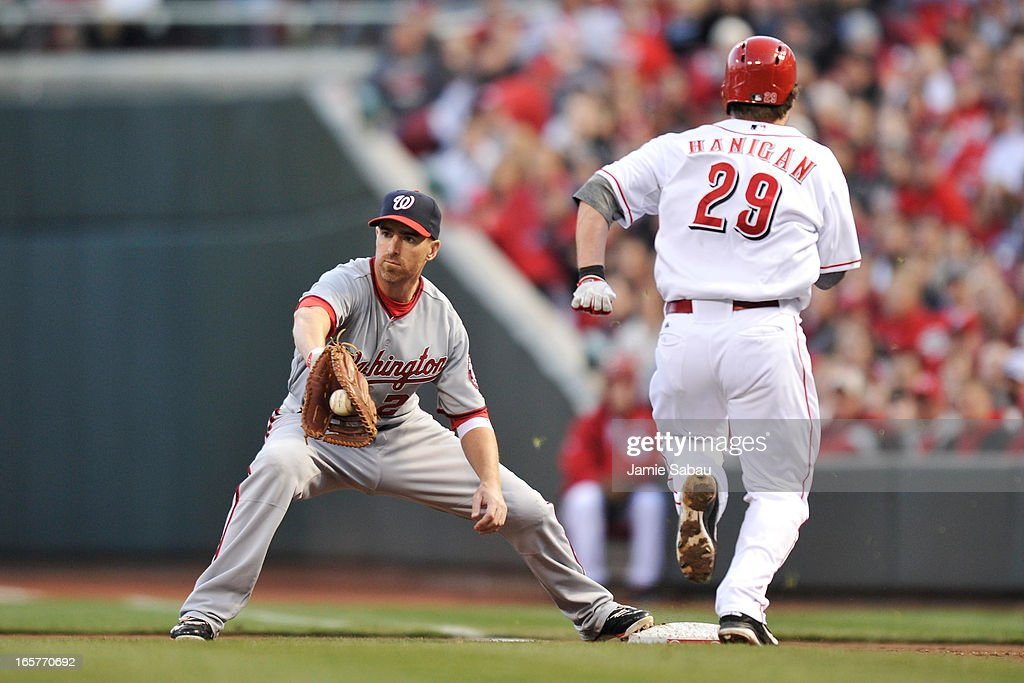 Adam LaRoche #25 of the Washington Nationals takes the throw to force out Ryan Hanigan #29 of the Cincinnati Reds in the second inning at Great American Ball Park on April 5, 2013 in Cincinnati, Ohio.