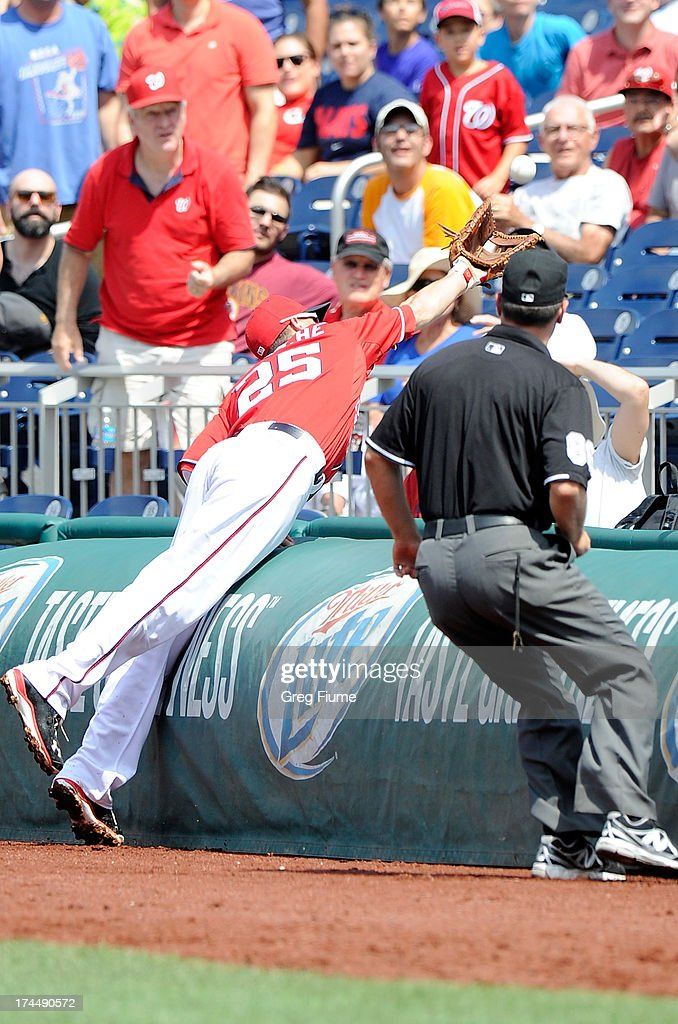 <a gi-track='captionPersonalityLinkClicked' href=/galleries/search?phrase=Adam+LaRoche&family=editorial&specificpeople=216533 ng-click='$event.stopPropagation()'>Adam LaRoche</a> #25 of the Washington Nationals tries to catch a foul ball in the fifth inning against the New York Mets at Nationals Park on July 26, 2013 in Washington, DC. New York won the game 11-0.