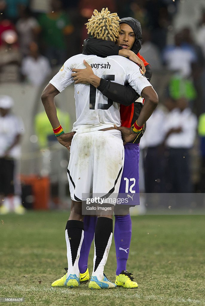 Adam Larsen Kwarasey of Ghana consoles <a gi-track='captionPersonalityLinkClicked' href=/galleries/search?phrase=Isaac+Vorsah&family=editorial&specificpeople=4401187 ng-click='$event.stopPropagation()'>Isaac Vorsah</a> (L)after he missed a penalty during the 2013 Orange African Cup of Nations 2nd Semi Final match between Burkina Faso and Ghana at Mbombela Stadium on February 06, 2013 in Nelspruit, South Africa.