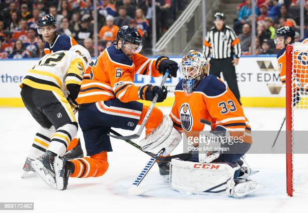 Adam Larsson and goaltender Cam Talbot of the Edmonton Oilers defend the net against Patric Hornqvist of the Pittsburgh Penguins at Rogers Place on...