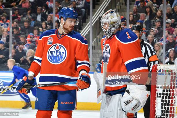 Adam Larsson and Laurent Brossoit of the Edmonton Oilers discuss the play during the game against the Colorado Avalanche on March 25 2017 at Rogers...