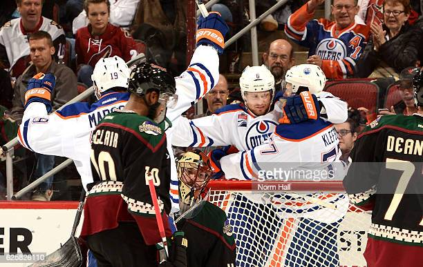 Adam Larsson and Oscar Klefbom of the Edmonton Oilers celebrate a first period goal against the Arizona Coyotes at Gila River Arena on November 25...