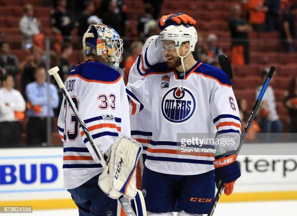 Adam Larsson congratulates Cam Talbot of the Edmonton Oilers after defeating the Anaheim Ducks 53 in Game One of the Western Conference Second Round...