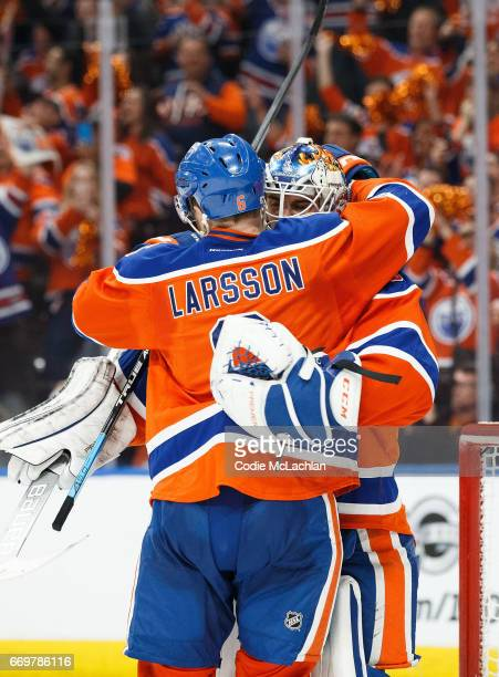 Adam Larsson congratulates goalie Cam Talbot of the Edmonton Oilers on his shutout victory against the San Jose Sharks in Game Two of the Western...