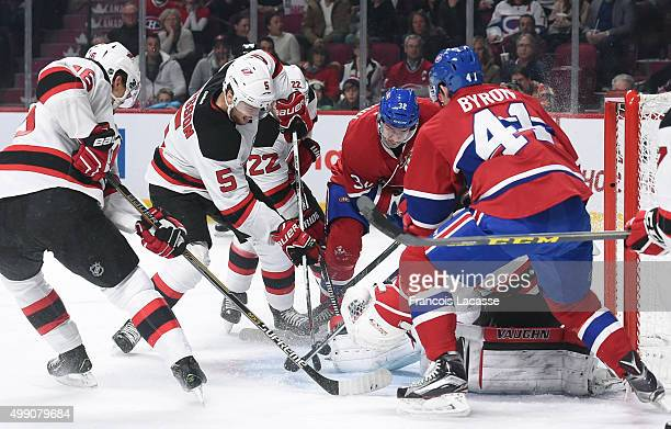 Adam Larsson Cory Schneider Jacob Josefson and Jordin Tootoo of the New Jersey Devils defend the goal against the Montreal Canadiens in the NHL game...