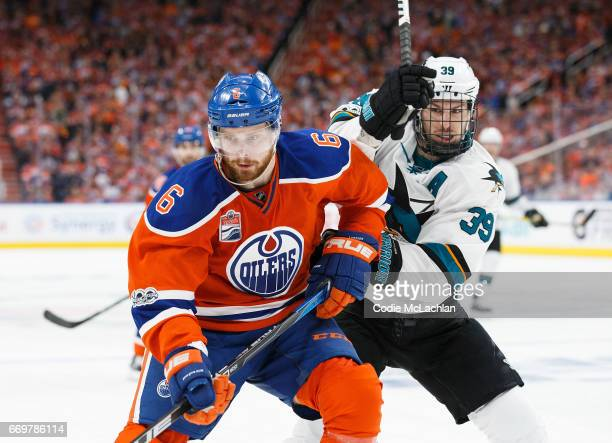 Adam Larsson of the Edmonton Oilers battles against Logan Couture of the San Jose Sharks in Game Two of the Western Conference First Round during the...