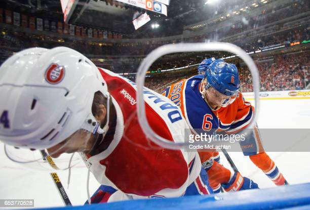 Adam Larsson of the Edmonton Oilers battles along the boards with Phillip Danault of the Montreal Canadiens on March 12 2017 at Rogers Place in...