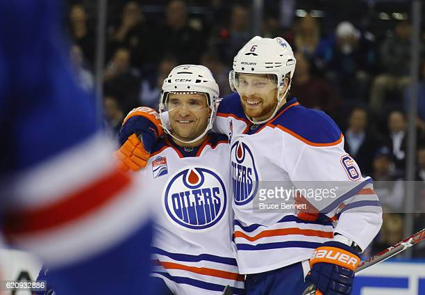 Adam Larsson of the Edmonton Oilers celebrates his third period goal against the New York Rangers and is joined by Andrej Sekera at Madison Square...