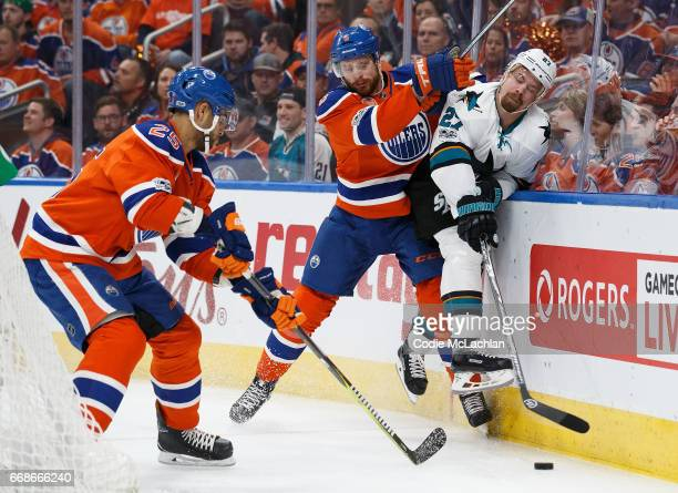 Adam Larsson of the Edmonton Oilers hits Joonas Donskoi of the San Jose Sharks in Game Two of the Western Conference First Round during the 2017 NHL...