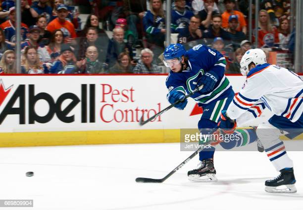 Adam Larsson of the Edmonton Oilers looks on as Brock Boeser of the Vancouver Canucks takes a shot during their NHL game at Rogers Arena April 8 2017...