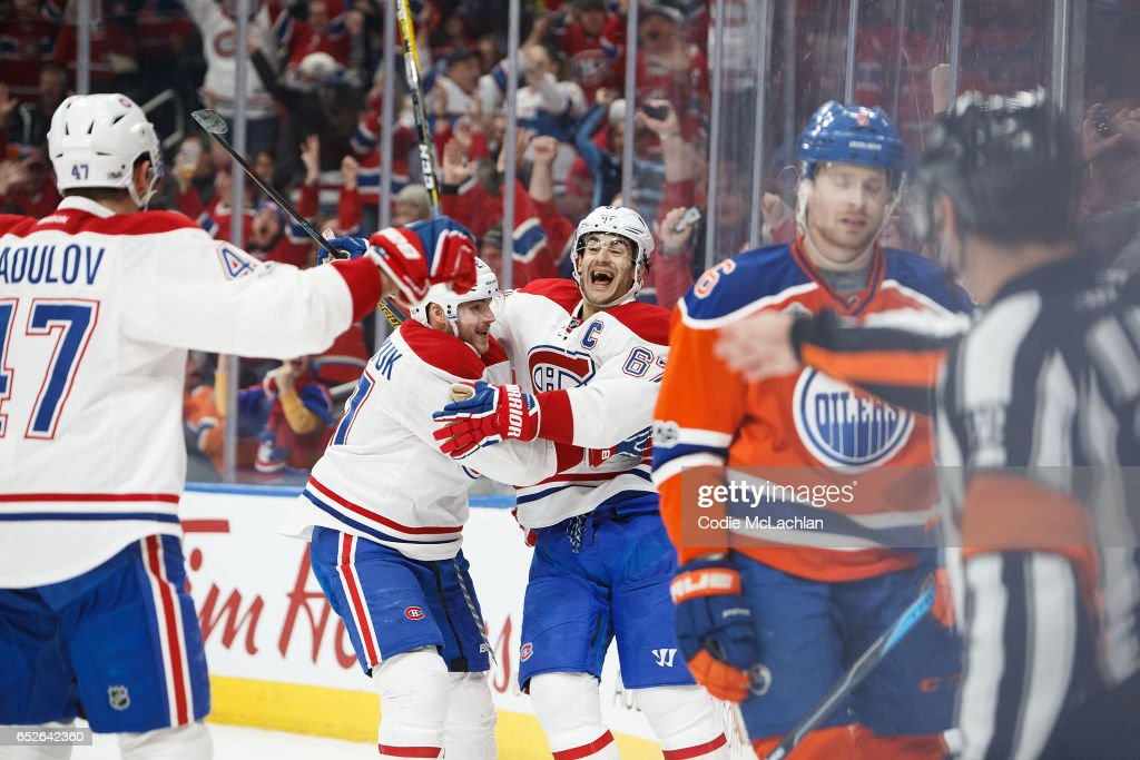 Adam Larsson #6 of the Edmonton Oilers reacts as Alexander Radulov #47, Alex Galchenyuk #27 and Max Pacioretty #67 of the Montreal Canadiens celebrate a goal on March 12, 2017 at Rogers Place in Edmonton, Alberta, Canada.
