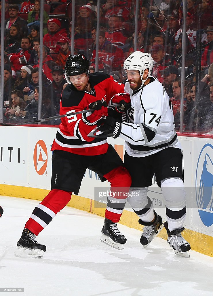 Adam Larsson #5 of the New Jersey Devils and Dwight King #74 of the Los Angeles Kings battle for position during the game at the Prudential Center on February 14, 2016 in Newark, New Jersey.