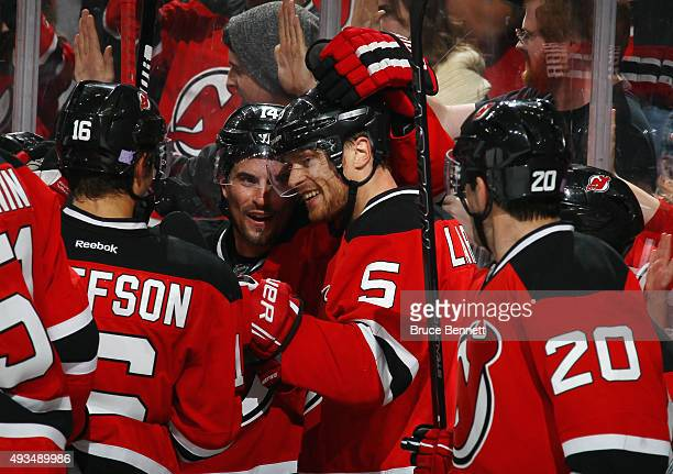 Adam Larsson of the New Jersey Devils celebrates his game winning goal at 43 seconds of overtime against the Arizona Coyotes at the Prudential Center...