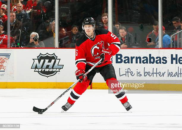 Adam Larsson of the New Jersey Devils controls the puck during the game against the Carolina Hurricanes at the Prudential Center on December 29 2015...