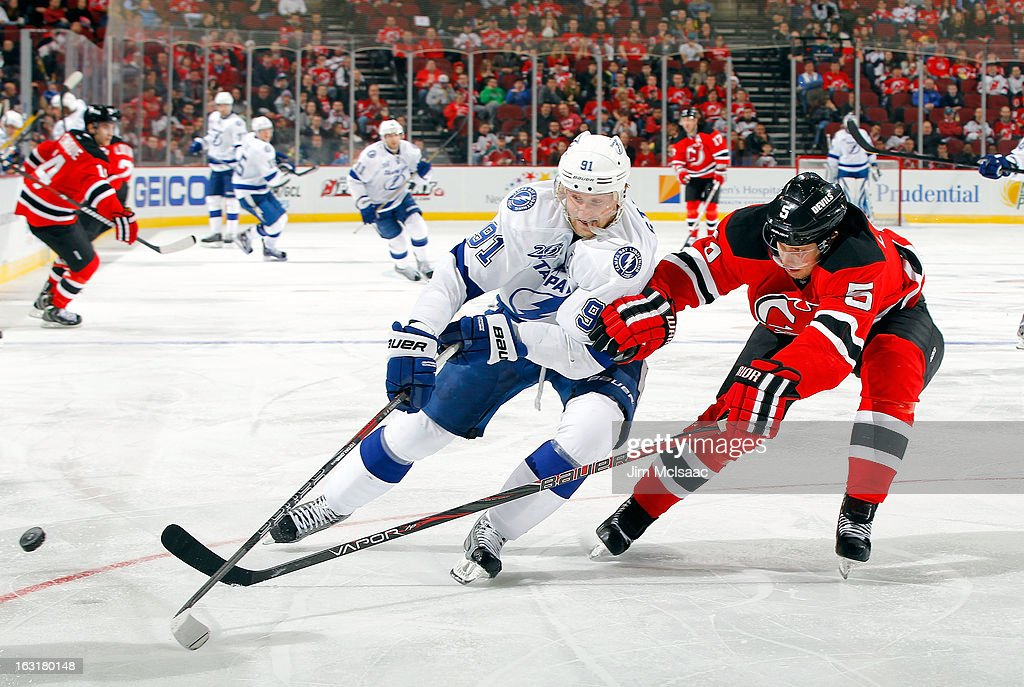 <a gi-track='captionPersonalityLinkClicked' href=/galleries/search?phrase=Adam+Larsson&family=editorial&specificpeople=6705080 ng-click='$event.stopPropagation()'>Adam Larsson</a> #5 of the New Jersey Devils defends against <a gi-track='captionPersonalityLinkClicked' href=/galleries/search?phrase=Steven+Stamkos&family=editorial&specificpeople=4047623 ng-click='$event.stopPropagation()'>Steven Stamkos</a> #91 of the Tampa Bay Lightning at the Prudential Center on March 5, 2013 in Newark, New Jersey.