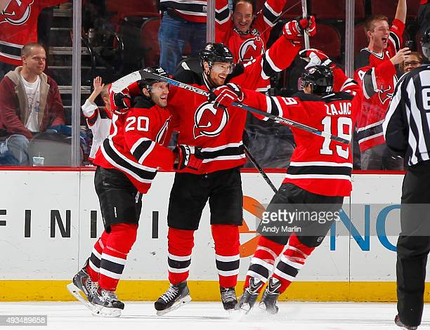 Adam Larsson of the New Jersey Devils is congratulated after scoring the game winning goal in overtime against the Arizona Coyotes at the Prudential...