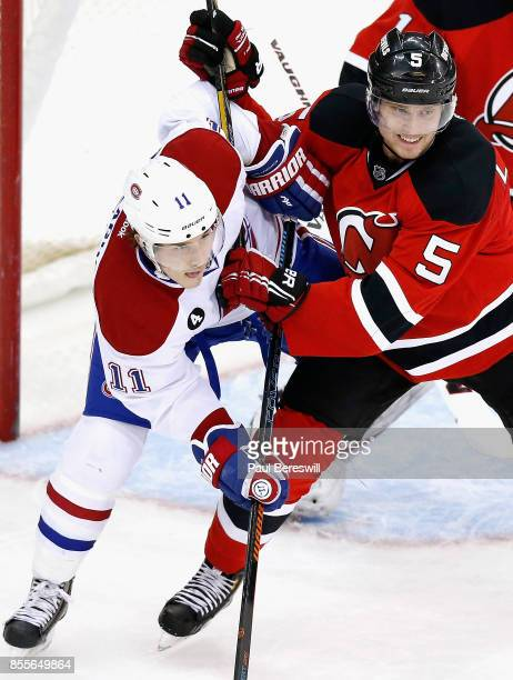 Adam Larsson of the New Jersey Devils plays in a game against Brendan Gallagher of the the Montreal Canadiens at Prudential Center on January 2 2015...