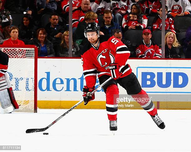 Adam Larsson of the New Jersey Devils plays the puck during the game against the New York Islanders at the Prudential Center on February 19 2016 in...