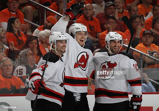 Adam Larsson of the New Jersey Devils scores at 308 of the third period against the Philadelphia Flyers and is joined by Adam Henrique and Peter...