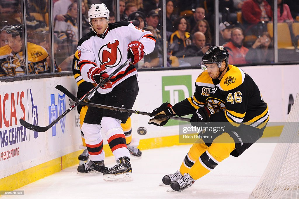 <a gi-track='captionPersonalityLinkClicked' href=/galleries/search?phrase=Adam+Larsson&family=editorial&specificpeople=6705080 ng-click='$event.stopPropagation()'>Adam Larsson</a> #5 of the New Jersey Devils skates against <a gi-track='captionPersonalityLinkClicked' href=/galleries/search?phrase=David+Krejci&family=editorial&specificpeople=722556 ng-click='$event.stopPropagation()'>David Krejci</a> #46 of the Boston Bruins at the TD Garden on October 26, 2013 in Boston, Massachusetts.