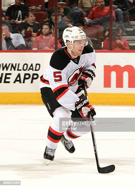 Adam Larsson of the New Jersey Devils skates the puck up ice against the Arizona Coyotes at Gila River Arena on March 14 2015 in Glendale Arizona