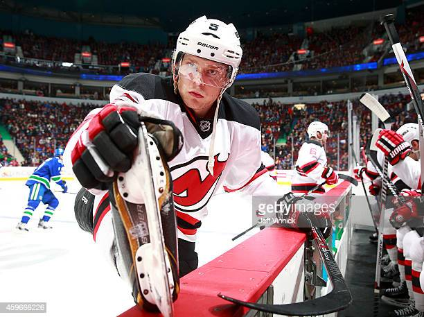 Adam Larsson of the New Jersey Devils stretches during their NHL game against the Vancouver Canucks at Rogers Arena November 23 2014 in Vancouver...