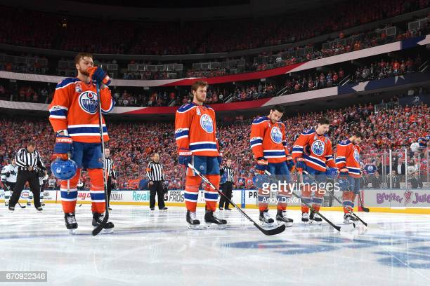 Adam Larsson Oscar Klefbom Milan Lucic Ryan NugentHopkins and Jordan Eberle of the Edmonton Oilers stand for the singing of the national anthem prior...