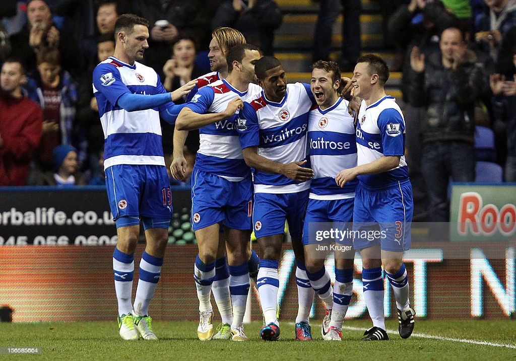 Adam Le Fondre (2ndR) celebrates his first goal with team mates during the Barclays Premier League match between Reading and Everton at Madejski Stadium on November 17, 2012 in Reading, England.