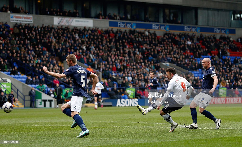 Adam Le Fondre of Bolton scores his sides first goal during the Sky Bet Championship match between Bolton Wanderers and Millwall at the Macron Stadium on March 14, 2015 in Bolton, England.