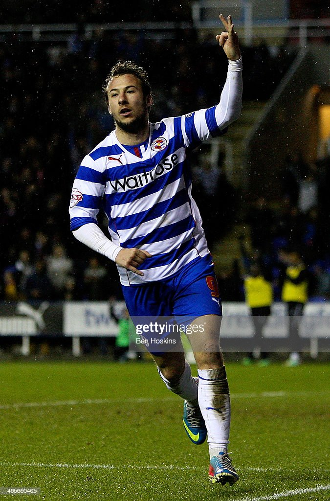 Adam Le Fondre of Reading celebrates after scoring his third and his team's fourth goal of the game during the Sky Bet Championship match between...