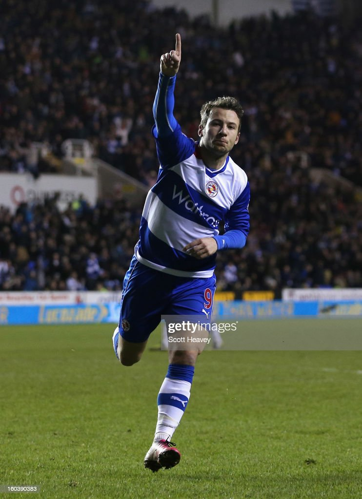 Adam Le Fondre of Reading celebrates his first goal during the Barclays Premier League match between Reading and Chelsea at Madejski Stadium on...