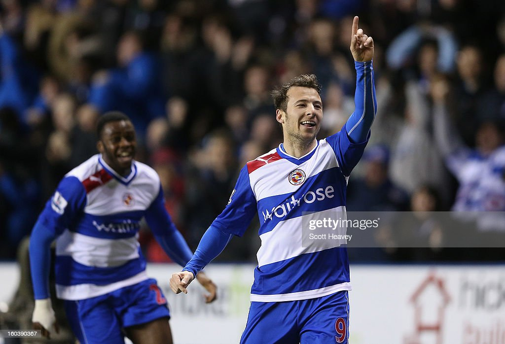Adam Le Fondre of Reading celebrates his second goal during the Barclays Premier League match between Reading and Chelsea at Madejski Stadium on...
