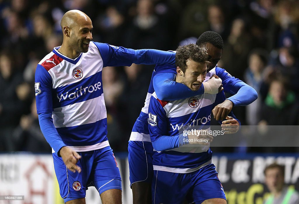 Adam Le Fondre of Reading celebrates his second goal with team mates during the Barclays Premier League match between Reading and Chelsea at Madejski Stadium on January 30, 2013 in Reading, England.