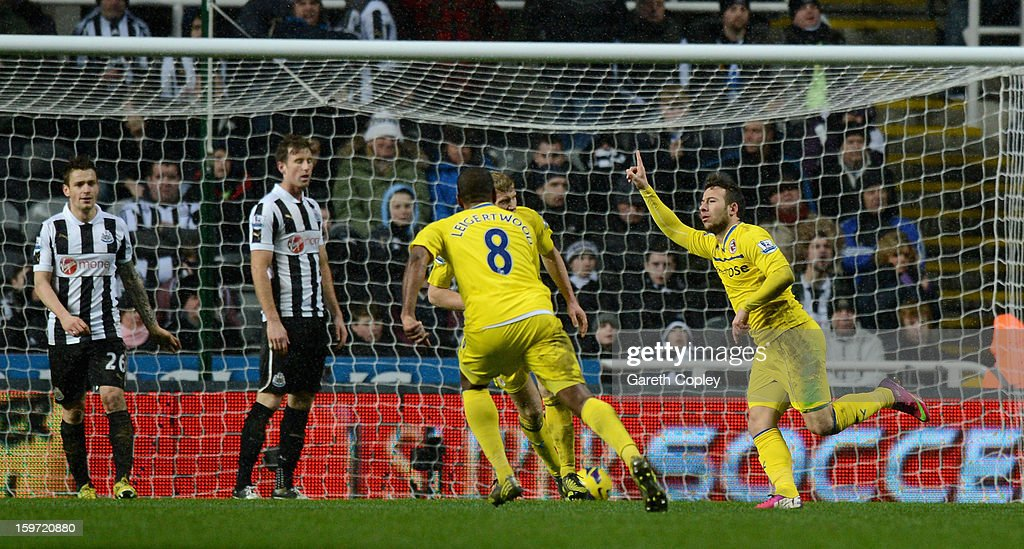 Adam le Fondre of Reading celebrates scoring the winning goal during the Barclays Premier League match between Newcastle United and Reading at St...