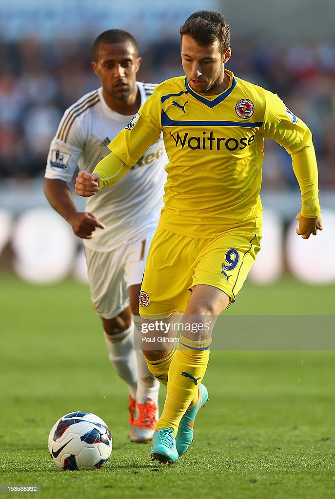 Adam Le Fondre of Reading gets away from <a gi-track='captionPersonalityLinkClicked' href=/galleries/search?phrase=Wayne+Routledge&family=editorial&specificpeople=206672 ng-click='$event.stopPropagation()'>Wayne Routledge</a> of Swansea City during the Barclays Premier League match between Swansea City and Reading at the Liberty Stadium on October 6, 2012 in Swansea, Wales.